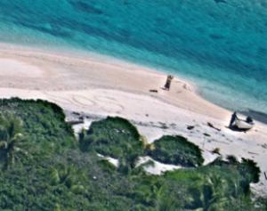 guam-310x245-300x237 Casal é resgatado de ilha deserta após escrever mensagem em praia
