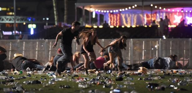 ao-menos-2-morrem-apos-atirador-abrir-fogo-em-festival-de-musica-em-las-vegas-1506928526868_615x300 Chega a 50 número de mortos em show country em Las Vegas