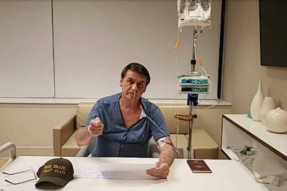 15683335875d7adf13564fd_1568333587_3x2_lg-585x390 Após retorno adiado, Bolsonaro faz vídeo com roupa hospitalar e sonda