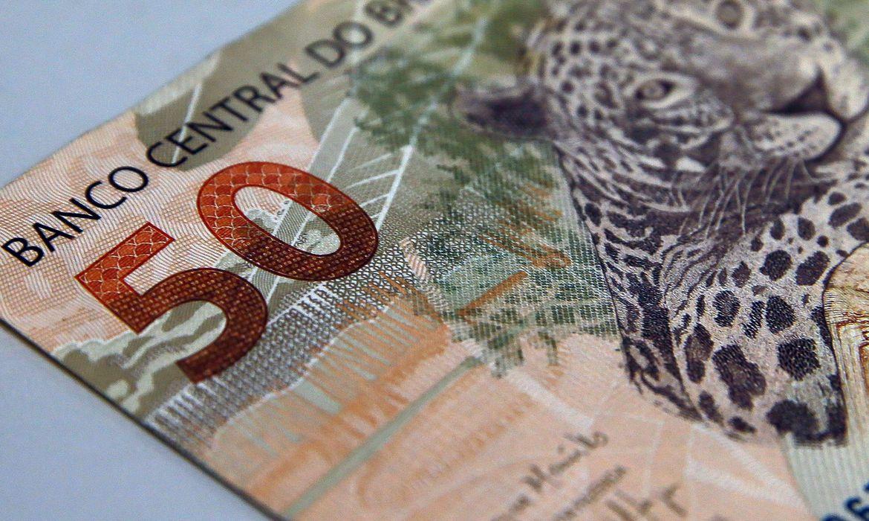 real_moeda_50_reais020120a84t47165203 Bolsonaro anuncia aumento do salário mínimo para R$ 1.100